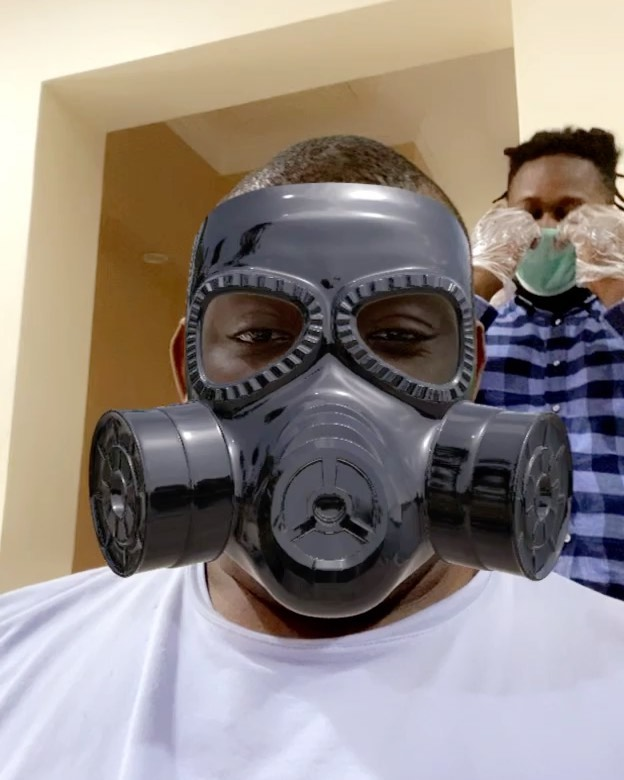 Don Jazzy wears Industrial Mask while barbing His Hair